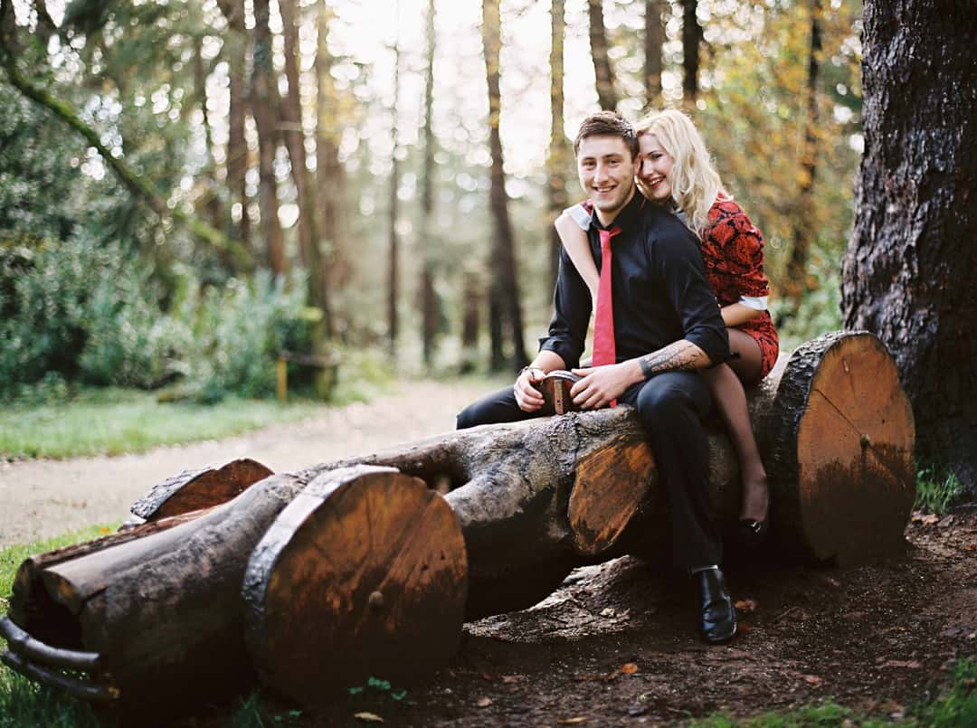couple on a wooden car during their engagement session