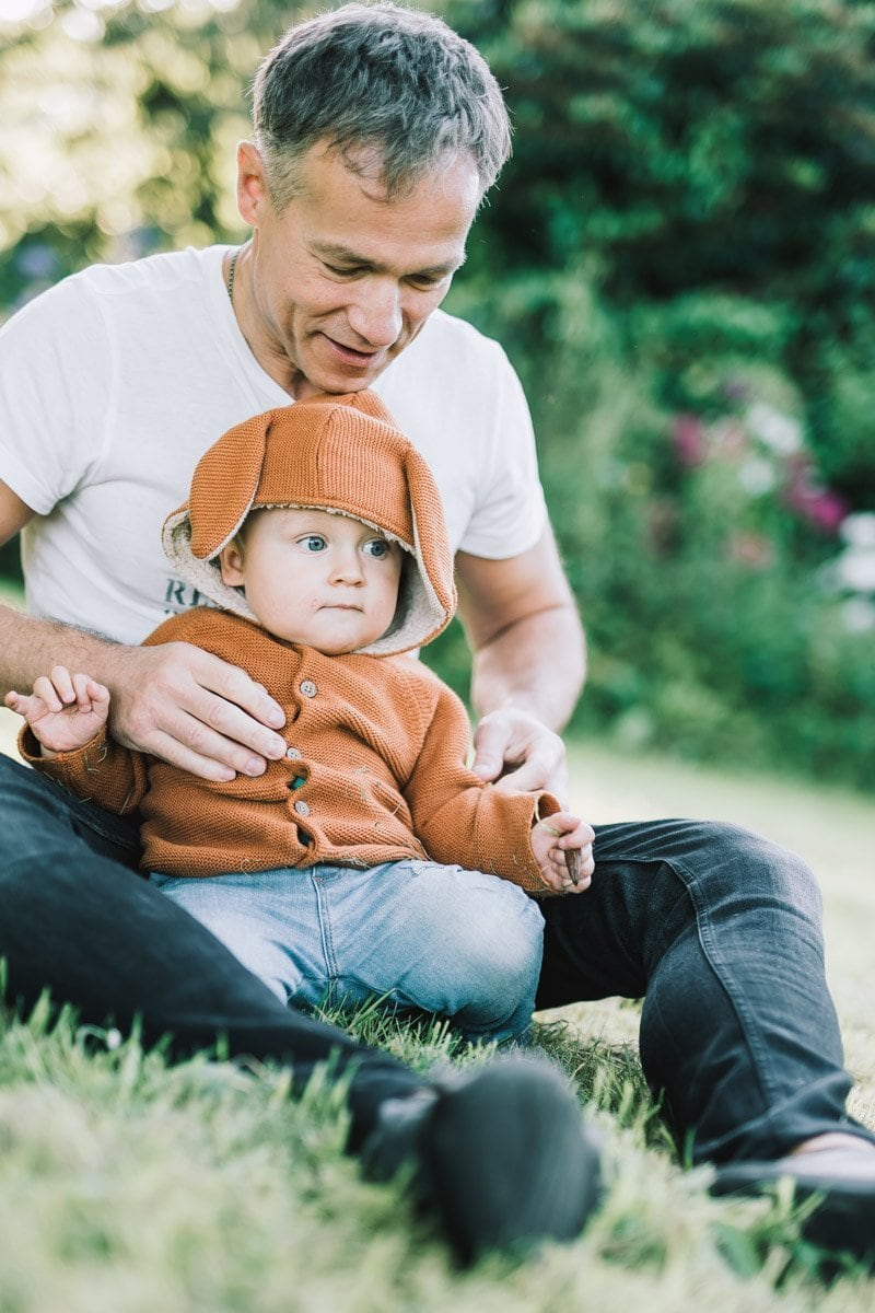 father and his son enjoyy photo session in the park