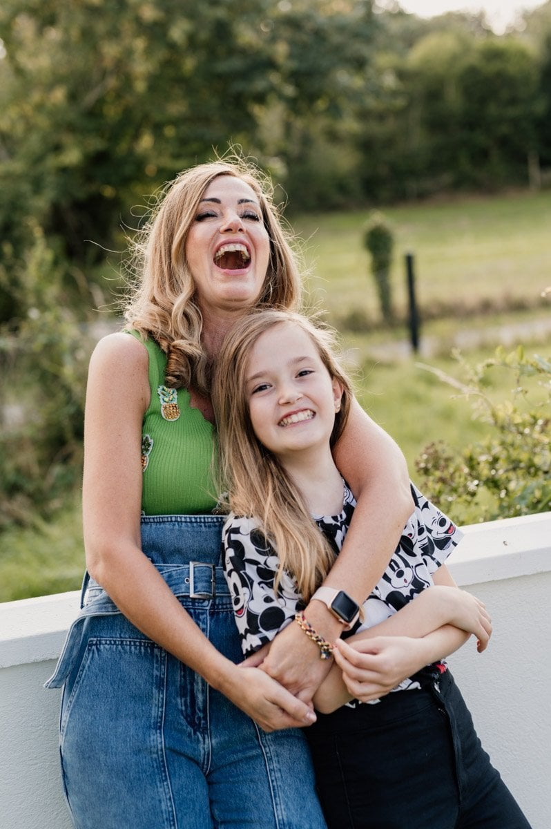 mother and daughter laughing on photo shoot
