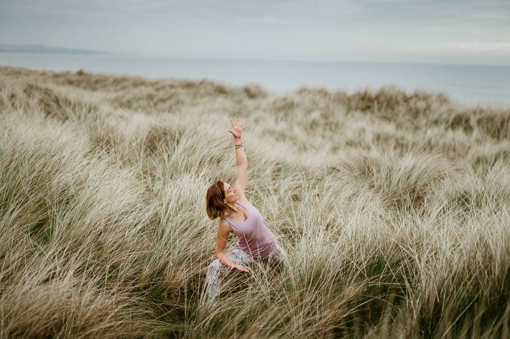 yoga teacher in dunes for her branded photo session
